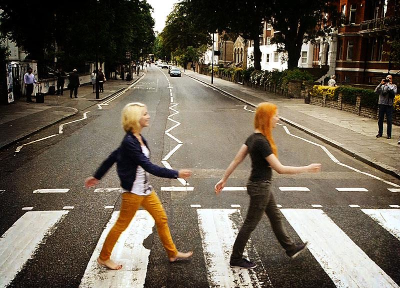 MonaLisa Twins walking the world-famous Abbey Road Zebra crossing in London, UK, 2009